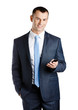 Businessman in suit and blue tie handing phone