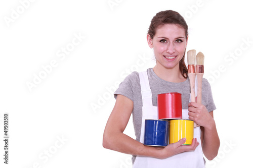 Girl with three cans of paint