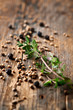 Assorted spices and thyme on wooden background