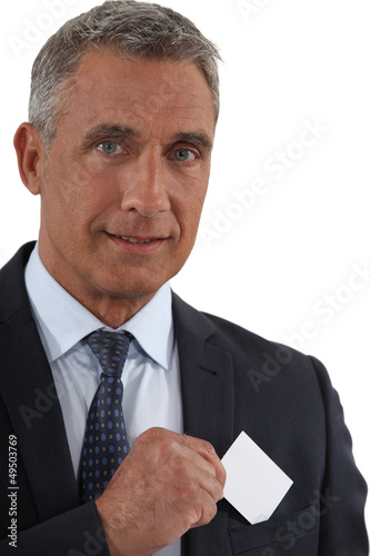 Executive removing business card from pocket