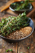 Coriander and mustard seeds with fresh thyme
