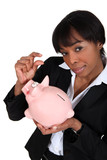 black businesswoman with piggybank