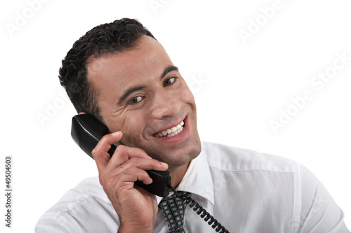 Businessman using land-line telephone