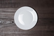 white plate on wooden brown table