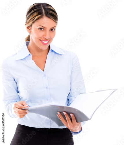 Businesswoman reading documents