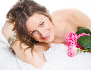Beautiful female holding roses