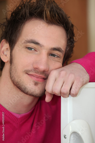 Man leaning on furniture
