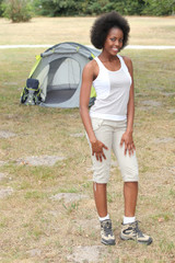 Woman stood by her tent