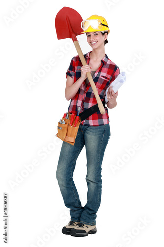 Female architect with shovel