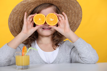 Girl with oranges and juice