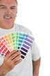 Decorator holding color charts