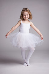 Happy little girl in dress ballerina