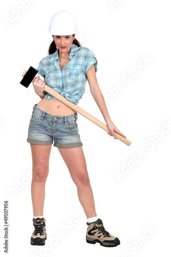 Woman holding sledge-hammer
