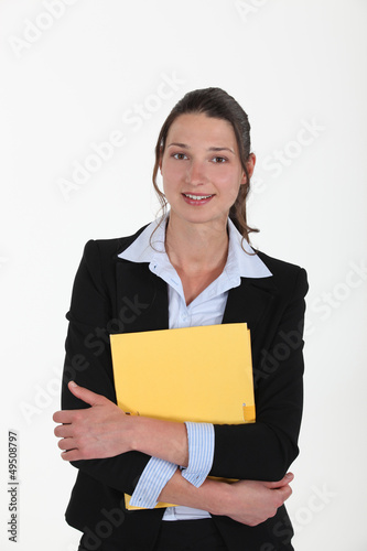 Brunette holding yellow folder
