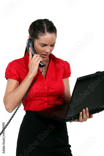 Young woman with laptop and phone
