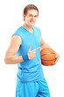 A smiling basketball player holding a ball and gesturing