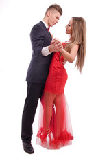 Young couple dancing on white background
