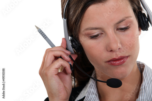 Brunette call-center worker listening to customer