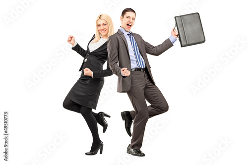 Full length portrait of a happy businesspeople celebrating succe