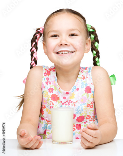 Cute little girl showing milk moustache
