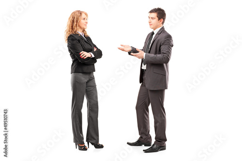 Full length portrait of a professional male and female having a