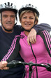 Mature couple on bike ride