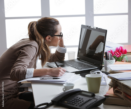 hard working woman with office files