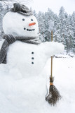 Snowman outside in snowfall