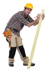 craftsman measuring a board