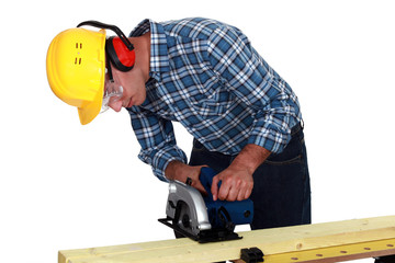 Carpenter using band saw