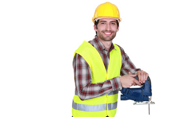 Construction worker holding a jigsaw