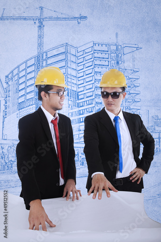 Architect and supervisor review blueprints