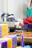Candle maker at work in a candle manufacture
