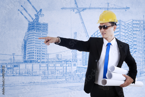 Architect pointing on something