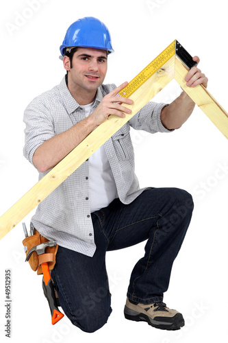 Carpenter with wood frame