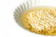 Noodles in a bowl on a white background