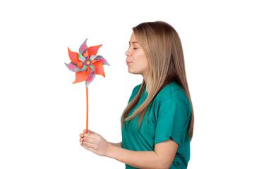 Funny girl blowing a pinwheel