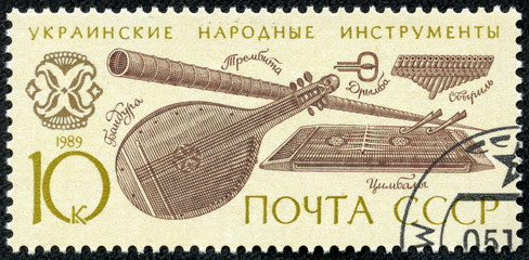 stamp shows Ukrainian folk music instruments