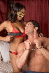 mystery love Interracial heterosexual sensual couple in bed
