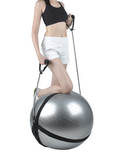 A woman exercise with gym ball and expander