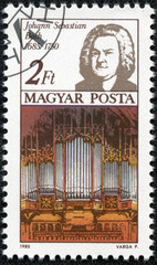 stamp shows Johann Sebastian Bach and Thomas Church organ