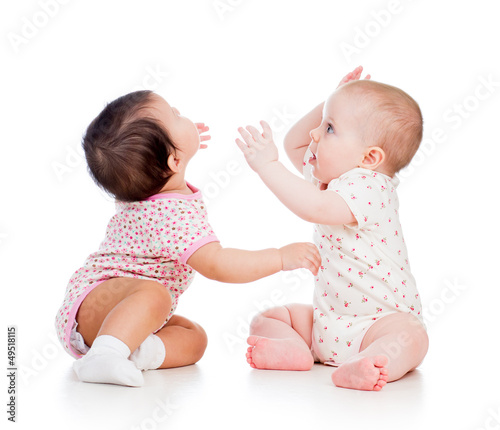 Funny babies girls playing together
