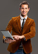 Young businessman showing laptop
