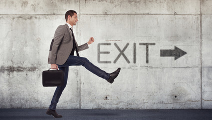Young businessman going to the exit