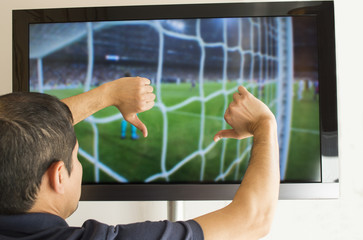 man watching football with your finger down- thumbs down