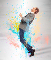 Young businessman screaming on splash colored