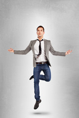 Young businessman jumping on yoga position.