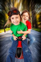 Siblings  on toy racing car