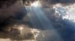 Leinwanddruck Bild - Sun rays through storm clouds
