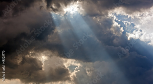 Foto op Canvas Onweer Sun rays through storm clouds